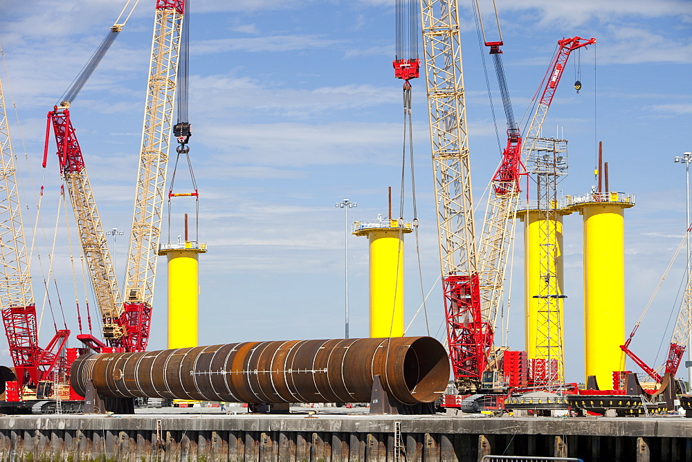 Manufacturing the foundations for off shore wind turbines for the Walney Wind Farm in the Irish Sea, at Dong Energy's site in Barrow in Furness, Cumbria, England, United Kingdom, Europe
