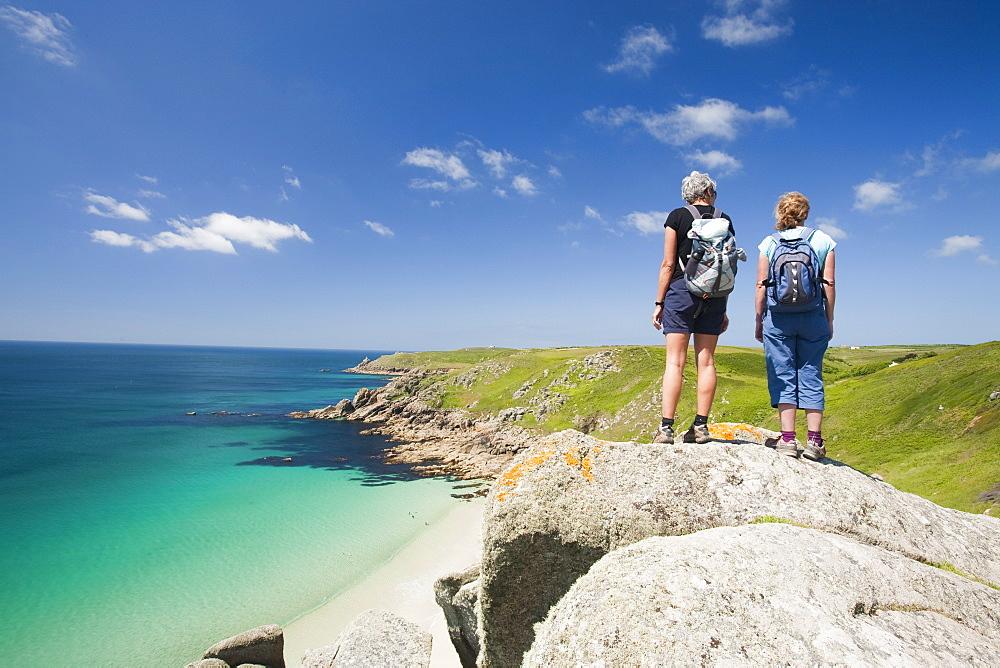 Walkers overlooking Porthcurno beach, Cornwall, England, United Kingdom, Europe