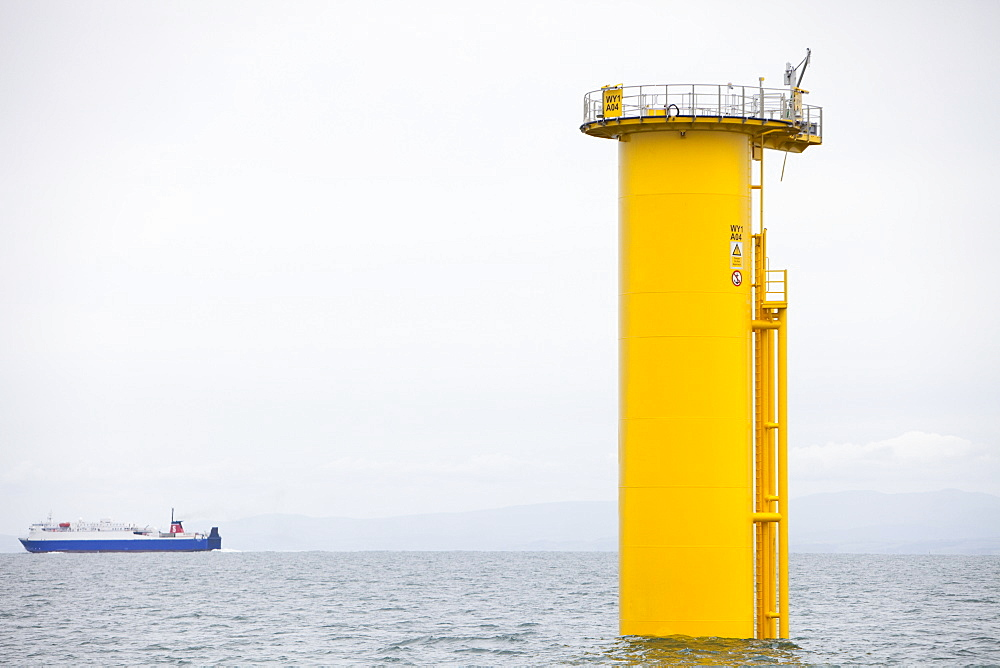 The yellow transition pieces that will hold the tower and turbine, that fit onto the monopile to hold the structure to the sea bed, Walney Offshore Wind Farm, Barrow in Furness, Cumbria, England, United Kingdom, Europe