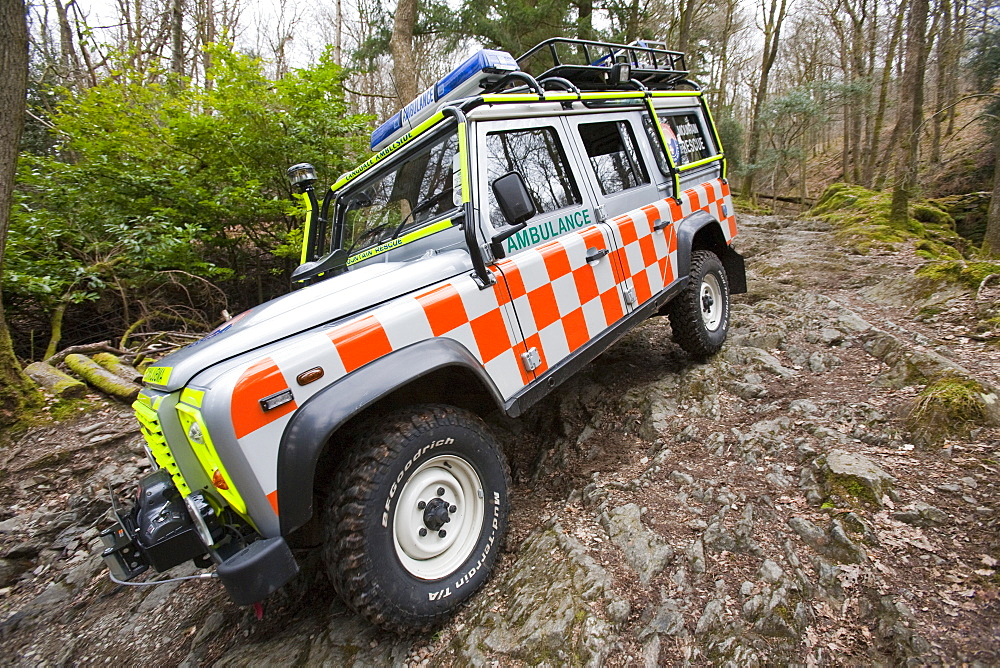 Langdale Ambleside Mountain Rescue Team Landrover off road on a mountain rescue above Ambleside in the Lake District, Cumbria, England, United Kingdom, Europe