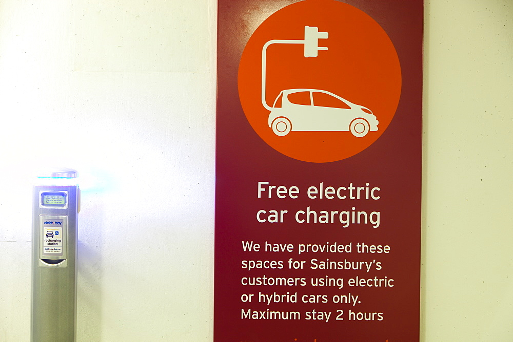 An electric vehicle charging station provided free of charge for customers at Camden Sainsbury's supermarket in London, England, United Kingdom, Europe