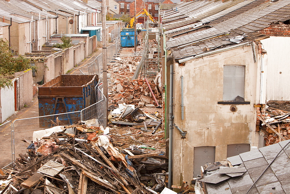 Timber being separated out for recycling at condemned houses being demolished in Barrow in Furness, Cumbria, England, United Kingdom, Europe