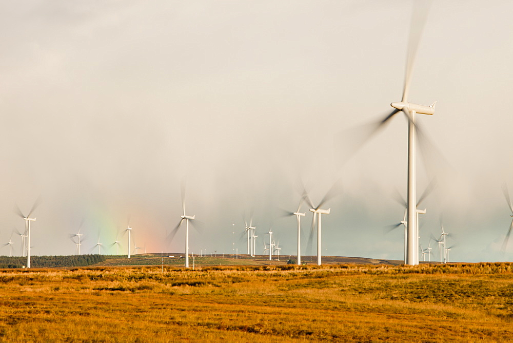 A rainbow over Whitlee wind farm on Eaglesham Moor just south of Glasgow in Scotland, United Kingdom, Europe