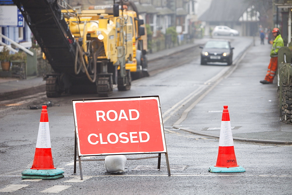 Resurfacing work in Ambleside after floods and harsh winter weather caused serious erosion of the road surface, Cumbria, England, United Kingdom, Europe