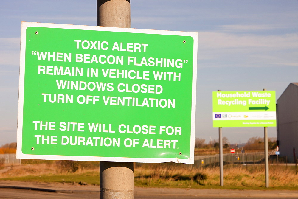 A warning sign about toxic air pollution outside a power from waste incinerator plant at Billingham on Teesside, England, United Kingdom, Europe - 911-7489