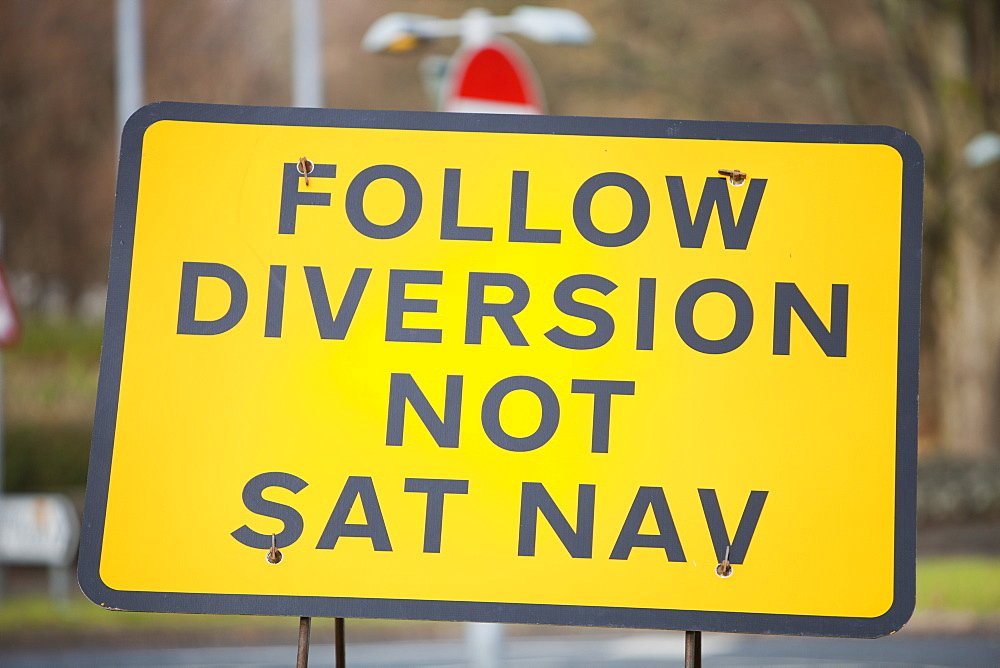 A road sign for a diversion round roadworks in Ambleside, Cumbria, England, United Kingdom, Europe