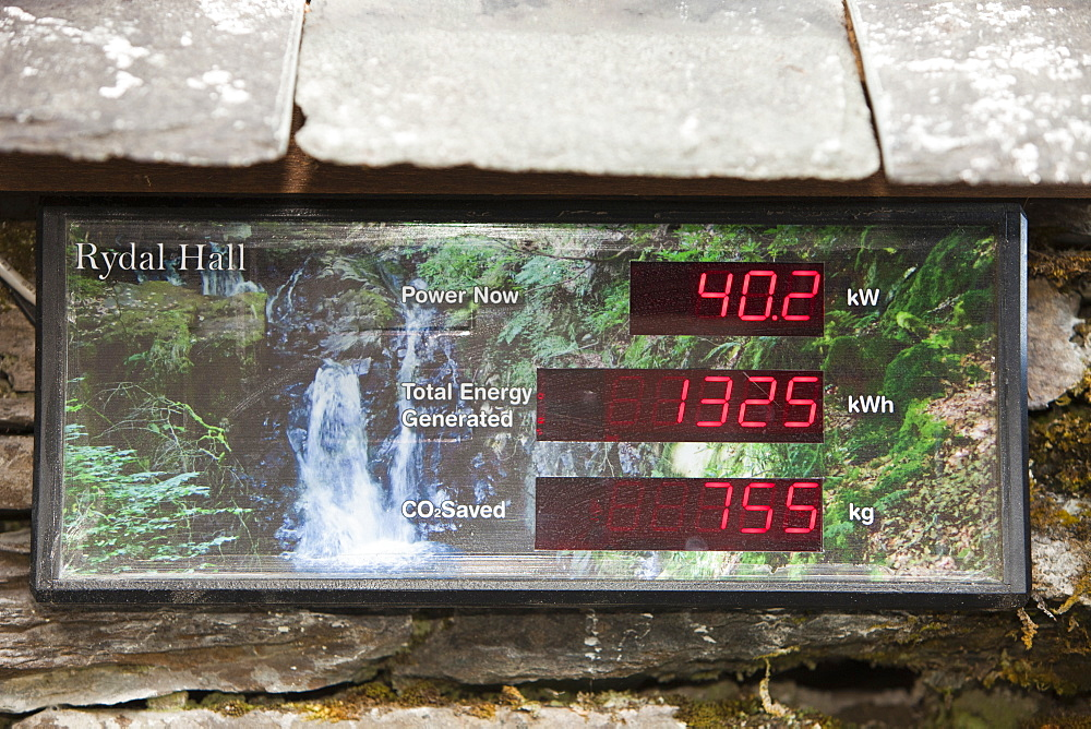 A display board showing the amount of renewable energy being generated by the micro hydro turbine in the grounds of Rydal Hall, Lake District Cumbria, England, United Kingdom, Europe
