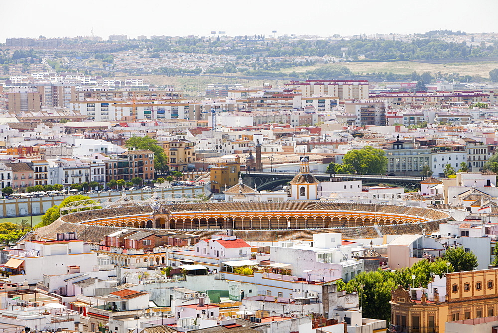 A view from the bell tower of Seville cathedral overlooking the city and the bull ring, Seville, Andalucia, Spain, Europe