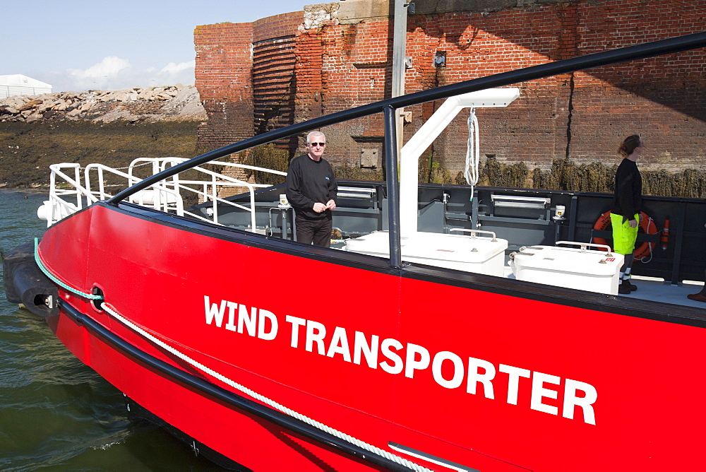 The Wind Transporter, a new support vessel to transport workers to The Walney Offshore Windfarm, 15km off Barrow in Furness in Cumbria, England, United Kingdom, Europe
