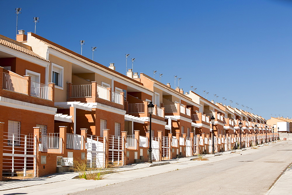A new build housing development that was abandoned when the Spanish economy collapsed during the recession, causing the developer to become bankrupt, near Sanlucar La Mayor, Spain. - 911-7730