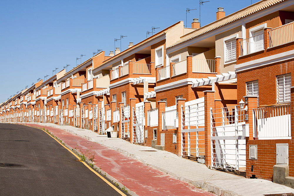 A new build housing development that was abandoned when the Spanish economy collapsed during the recession, causing the developer to become bankrupt, near Sanlucar La Mayor, Spain. - 911-7731
