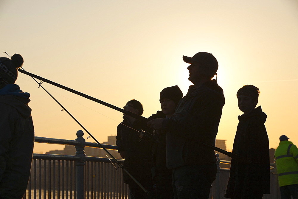 Fishermen sea fishing at Wearmouth in Sunderland, Tyne and Wear, England, United Kingdom, Europe