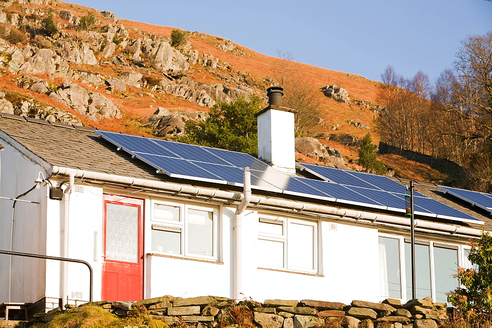 Solar panels on Council houses in Chapel Stile in the Langdale Valley, Lake District, Cumbria, England, United Kingdom, Europe - 911-7904