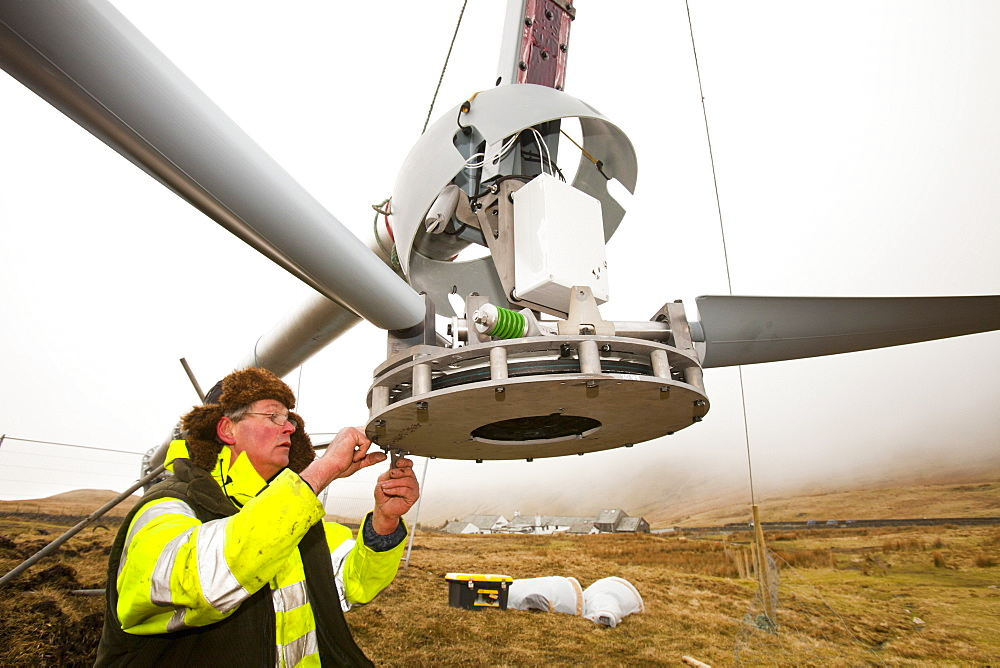 Three wind turbines being constructed behind the Kirkstone Pass Inn on Kirkstone Pass in the Lake District, Cumbria, England, United Kingdom, Europe - 911-7917