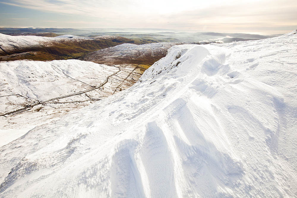 Drifting snow on the summit of Red Screes in the Lake District, Cumbria, England, United Kingdom, Europe