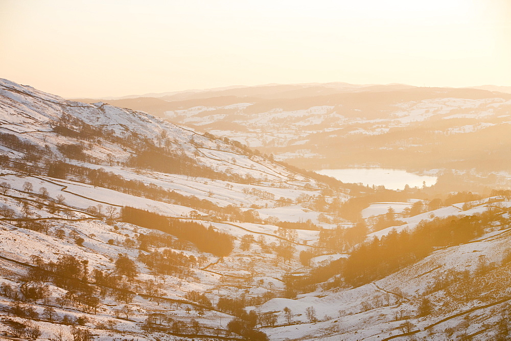 Looking down towards Ambleside and Lake Windermere from Kirkstone Pass at sunset, Lake District, Cumbria, England, United Kingdom, Europe