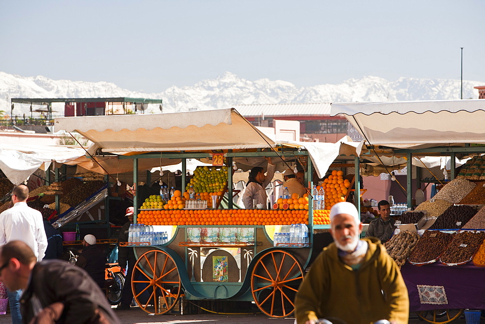 Orange juice stall with the Atlas mountains covered in snow behind, Marrakech, Morocco, North Africa, Africa