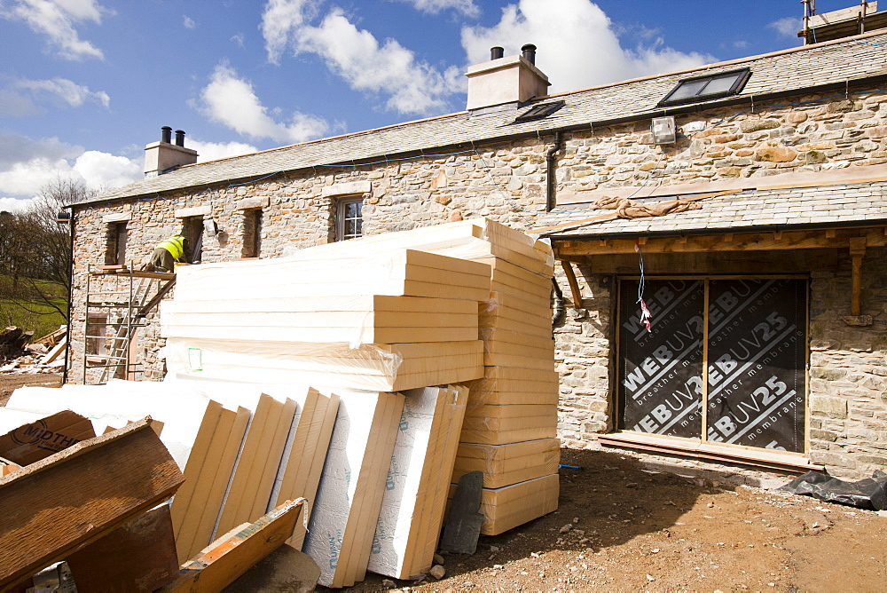 Insulation blocks going into the building conversion at the Hyning in Grayrigg, an old farmhouse and barns being converted into eight holiday letting properties, near Kendal, Cumbria, England, United Kingdom, Europe