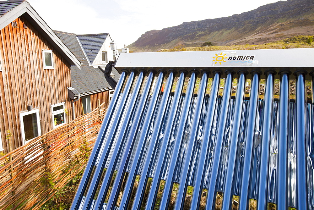 Solar thermal panels on a house on the Isle of Eigg which is 98% powered by renewable energy, west coast, Scotland, United Kingdom, Europe - 911-8270