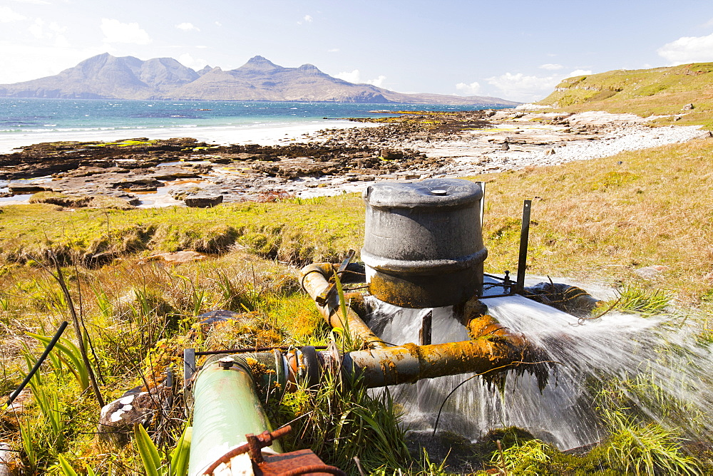 A home made hydro turbine on the Isle of Eigg , with the Isle of Rhum in the background, Scotland, United Kingdom, Europe