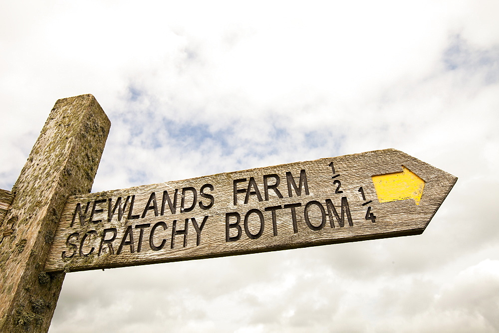 A signpost on the Dorset coast for the funnily named Scratchy Bottom, near Lulworth, Dorset, England, United Kingdom, Europe