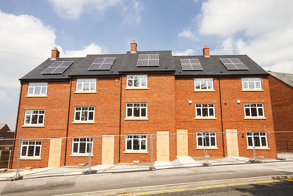 Solar panels on new build housing in Macclesfield, Cheshire, England, United Kingdom, Europe