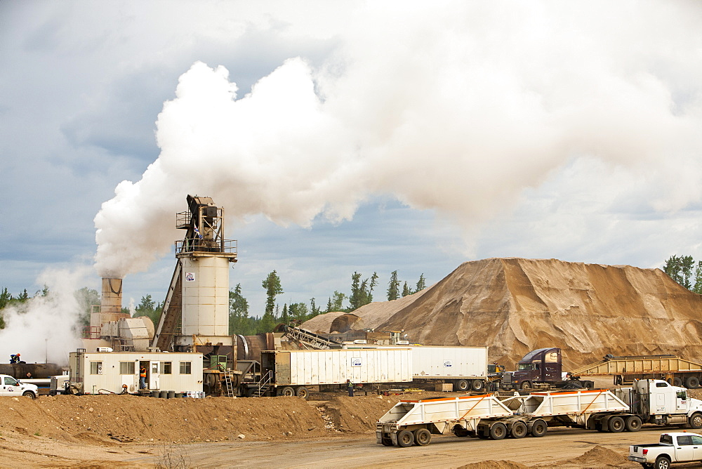 A sand and gravel strip mine producing materials to support the tar sands industry on Highway 63, Alberta, Canada, North America
