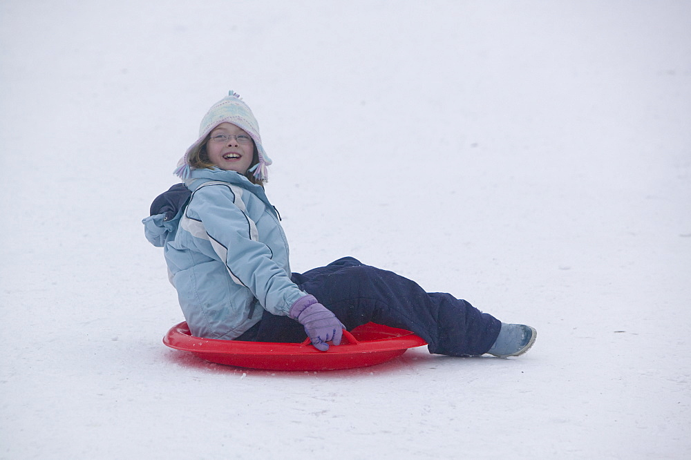 Child playing in the snow in Aviemore, Scotland, United Kingdom, Europe