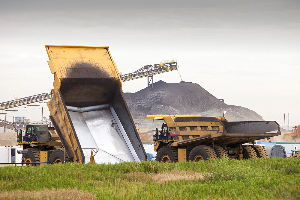 Massive dump trucks used in the tar sands, Alberta, Canada, North America