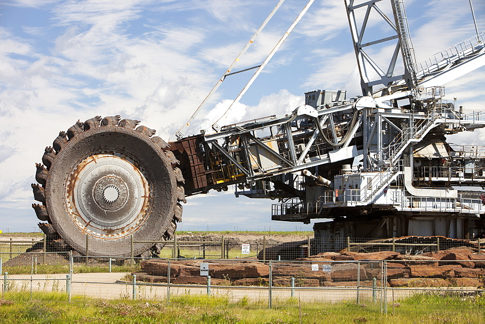 A massive bucket wheel by the Syncrude upgrader plant, Alberta, Canada, North America