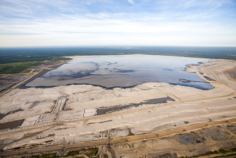 The tailings pond at a mine north of Fort McMurray, Alberta, Canada, North America