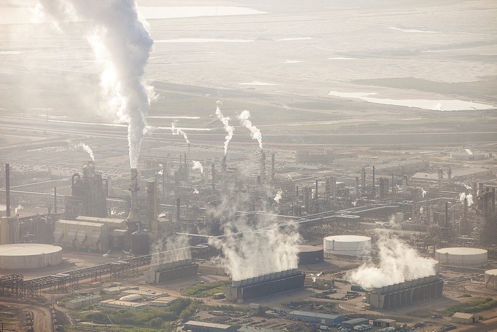 Hideous air pollution from the Syncrude Tar sands upgrader plant north of Fort McMurray, Alberta, Canada, North America