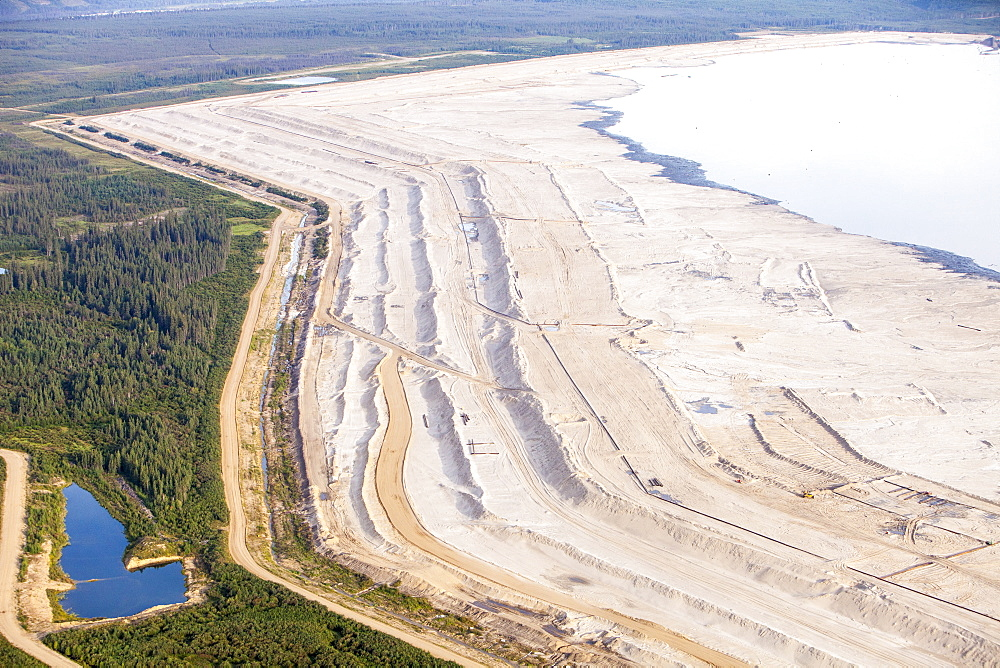 The tailings pond at the Syncrude mine north of Fort McMurray, Alberta, Canada, North America