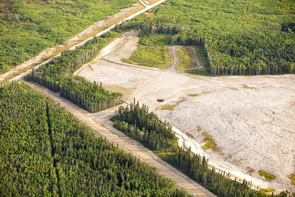 Boreal forest trees clear felled to make way for a new tar sands mine north of Fort McMurray, Alberta, Canada, North America