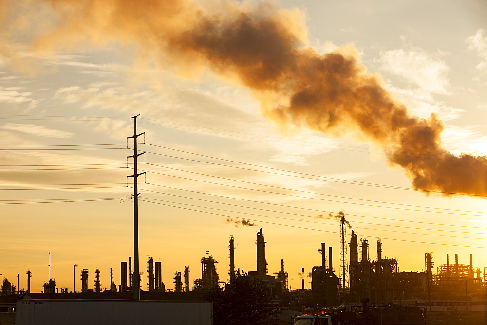 The tar sands upgrader plant at the Syncrude mine north of Fort McMurray at sunset, Alberta, Canada, North America