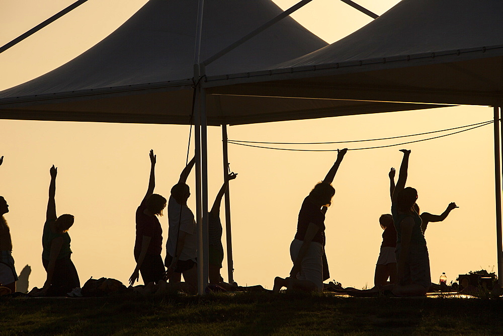 A stretch and relax class at sunset at a holiday complex in Myrina on Lemnos, Greek Islands, Greece, Europe