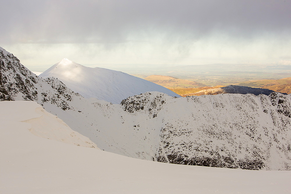 Climbers on Striding Edge on Helvellyn, looking towards Catstycam in the Lake District National Park, Cumbria, England, United Kingdom, Europe