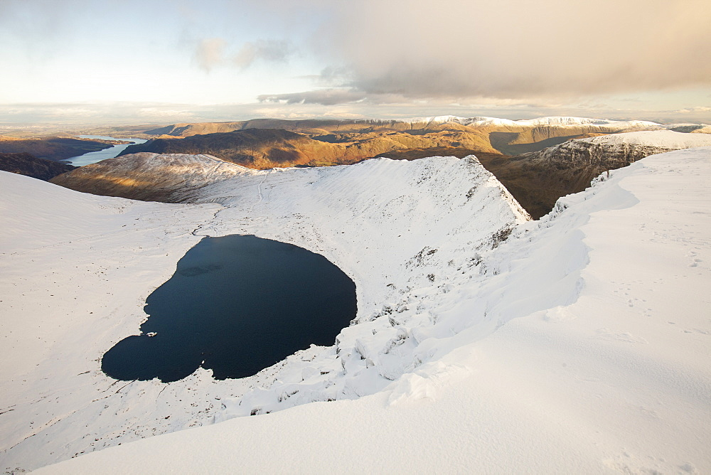 The summit plateau of Helvellyn looking down towards Red Tarn and Striding Edge, Lake District National Park, Cumbria, England, United Kingdom, Europe