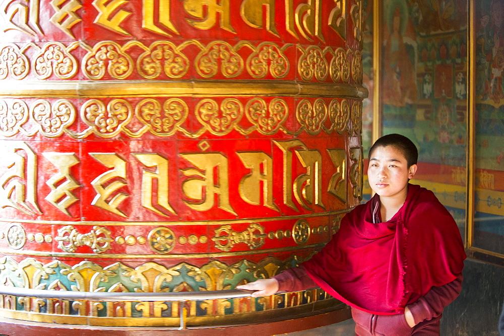 A massive prayer wheel at the Boudhanath Stupa, one of the holiest Buddhist sites in Kathmandu, Nepal, Asia