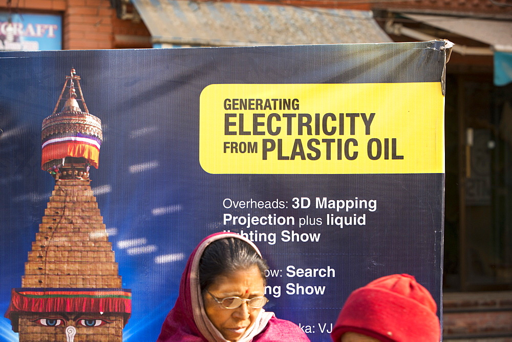 A machine used for turning plastic into oil, to generate electricity is demonstrated to crowds in Kathmandu, Nepal, Asia