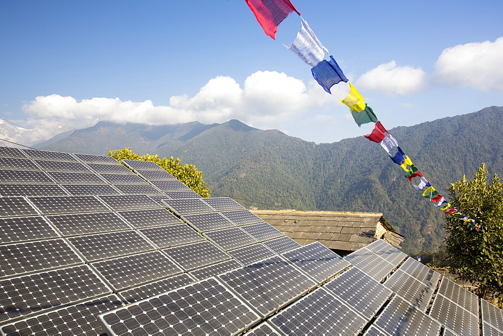 Solar photo voltaic panels being used to power a mobile phone mast at Ghandruk, Himalayas, Nepal, Asia