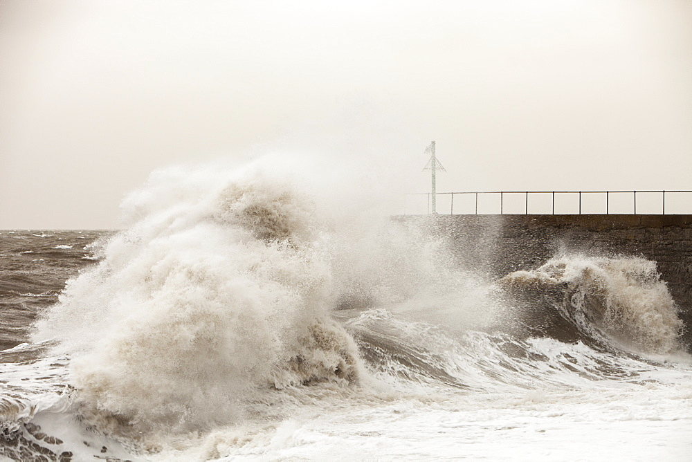 Gale force winds and crashing waves battering the coastal defences in Harrington, Workington, Cumbria, England, United Kingdom, Europe - 911-9449