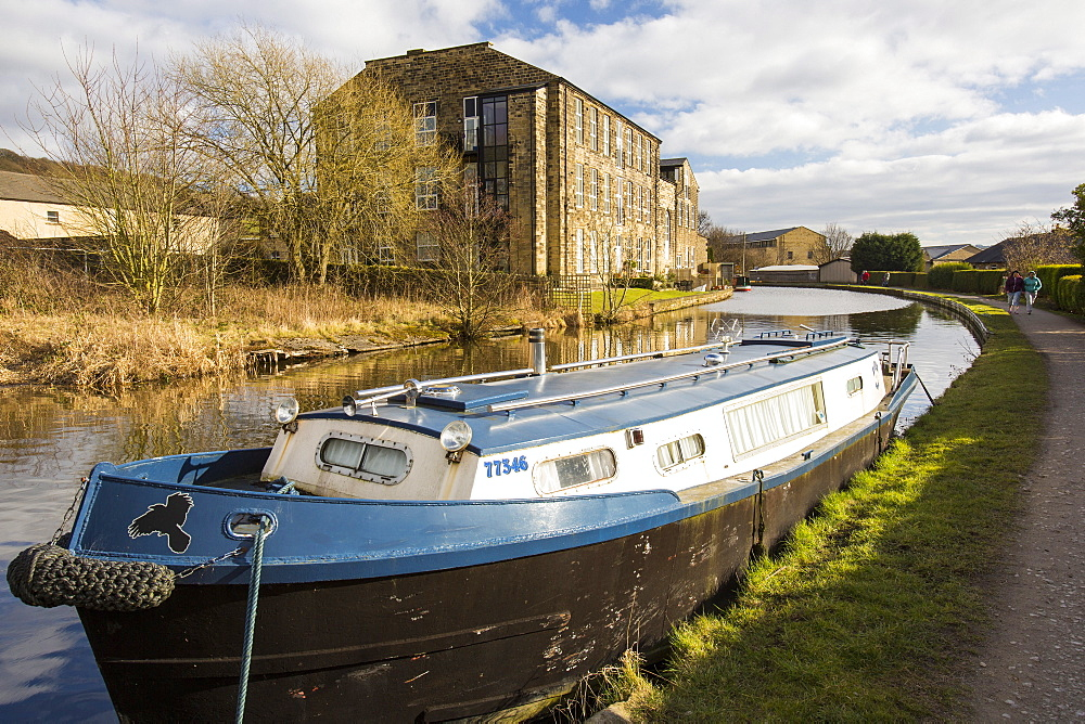 An old cotton mill converted into housing on the Leeds Liverpool Canal at Bingley, West Yorkshire, England, United Kingdom, Europe