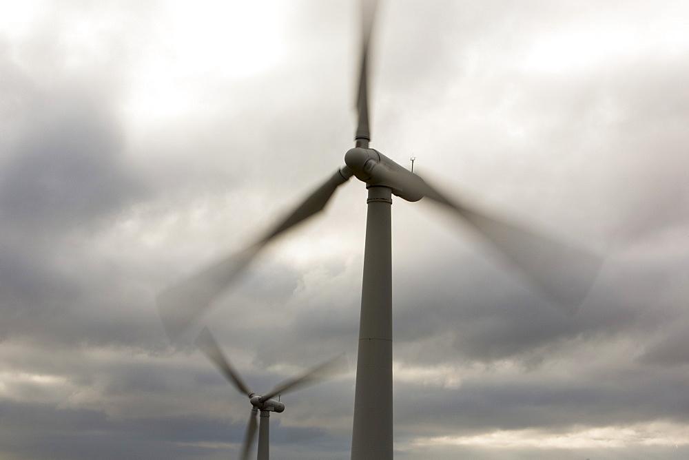 Wind turbines at a wind farm near Amlwych on Anglesey, Wales, United Kingdom, Europe
