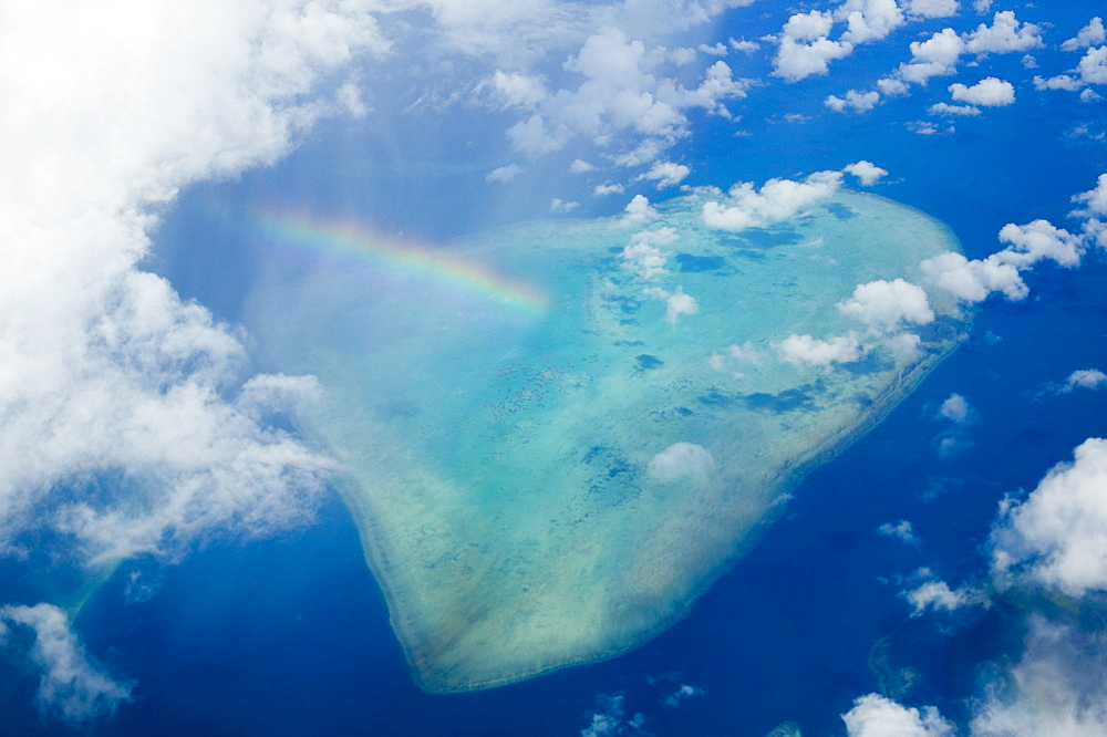 A rainbow over tropical reef near Tuvalu in the Pacific Ocean, Pacific