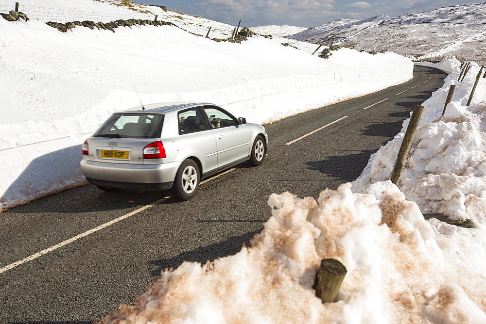 Massive snow drifts on the side of the Kirkstone Pass road during the extreme weather event of late March 2013, above Ambleside in the Lake District, Cumbria, England, United Kingdom, Europe