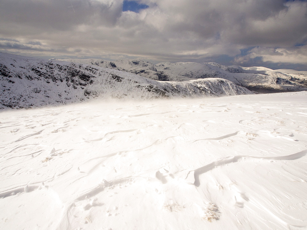 Looking towards Helvellyn fom Gray Crag during unseasonally cold weather in late March 2013, with drifting snow, Lake District National Park, Cumbria, England, United Kingdom, Europe