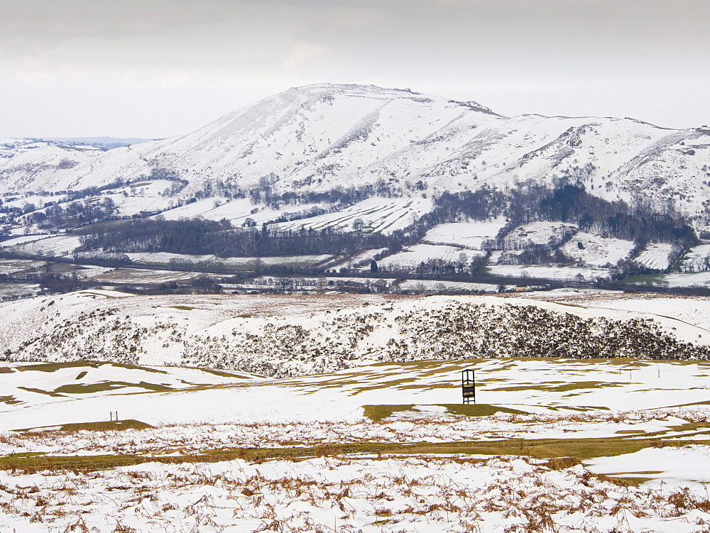 Church Stretton golf course covered in snow in late March, looking towards Caer Caradoc, Shropshire, England, United Kingdom, Europe