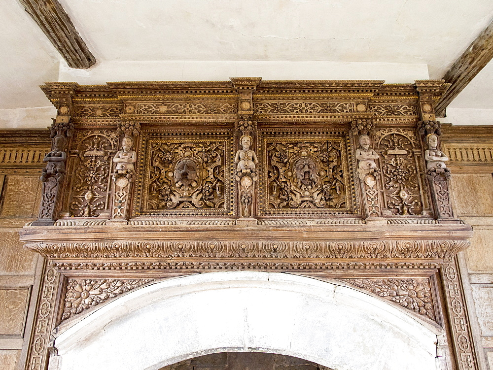 Intricate wood carving above the fire place in Stokesay Castle, a fortified manor house built in the late 13th century, in Stokesay, near Craven Arms, Shropshire, England, United Kingdom, Europe