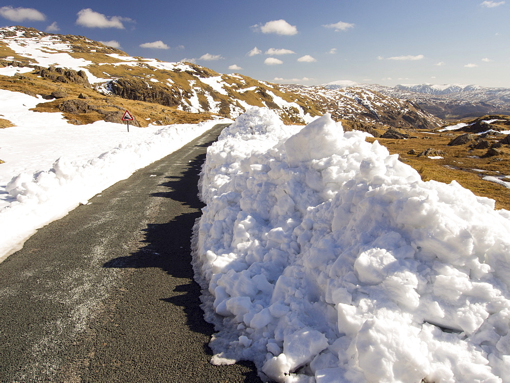 Massive snow drifts on the side of the Wrynose Pass road during the extreme weather event of late March 2013, Lake District, Cumbria, England, United Kingdom, Europe